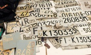 ROME, ITALY: An Italian policeman presents car's number plates, 21 December 2003 in the police headquarters in Rome, after the discovery of a huge weapons cache containing also around 100 kilogrammes of explosives, 200 detonators, hand grenades, a small M12 machine gun, police and carabinieri uniforms, computers and hard discs, and pamphlets claiming responsibility for several attacks, discovered during a raid last night, on a house belonging to the Red Brigades, the country's most feared extremist movement. Documents belonging to Nadia Desdemona Lioce were also found. Her arrest in March re-launched the inquiry into the murders of two Italian labour ministry officials Massimo D'Antona and Marco Biagi, who were killed respectively in Rome in 1999 and Bologna in 2002. AFP PHOTO/Andreas SOLARO (Photo credit should read ANDREAS SOLARO/AFP/Getty Images)